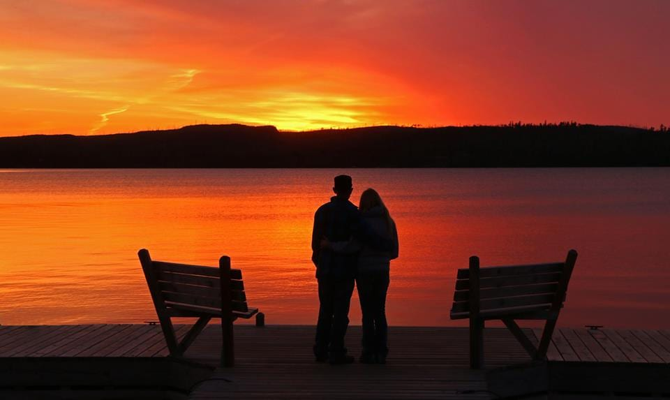 Gunflint Lodge Couples Spa Package couple at sunset standing on dock