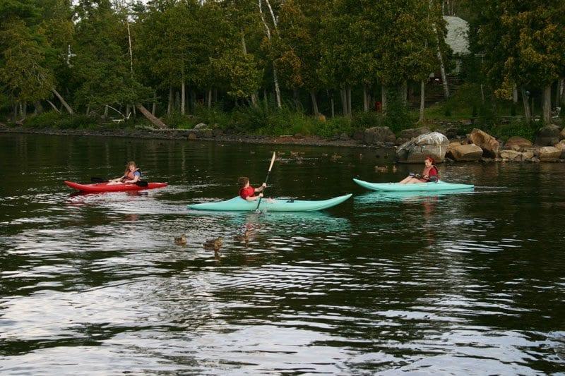 Gunflint Lodge Free Kids Weekend 3 kids in kayaks with ducks