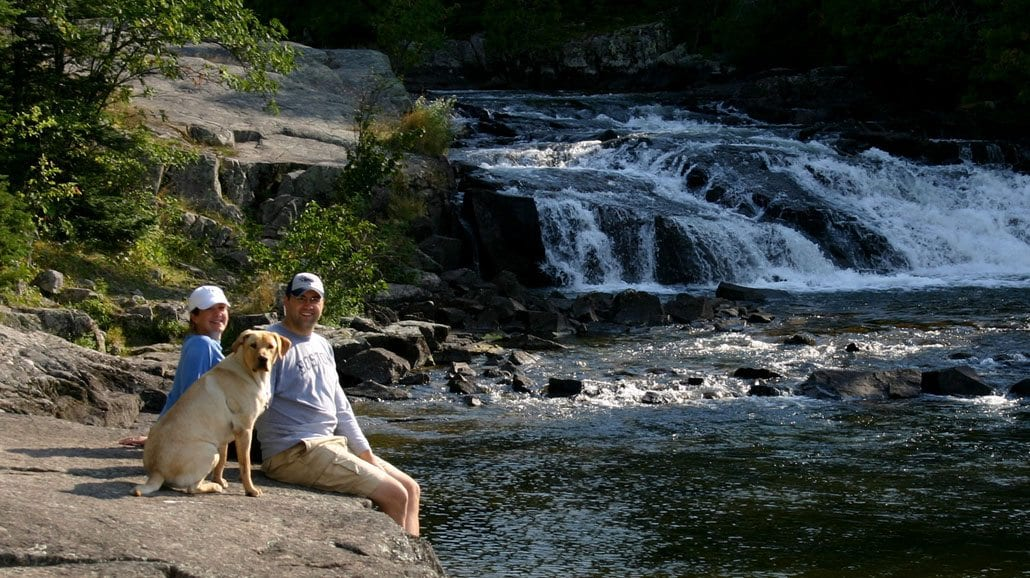 Gunflint Lodge Couple By Falls With Pet